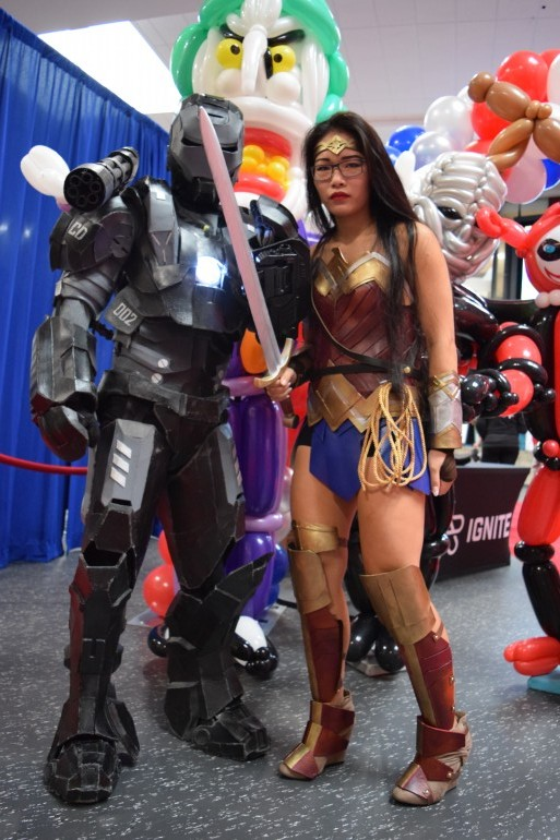 Guelph-Humber students, Charleston Festejo(left) posing as WarMachine which won first place in the Costume contest beside Katlyn Tran(right) as Wonder Woman at Humber Colleges comic-expo.