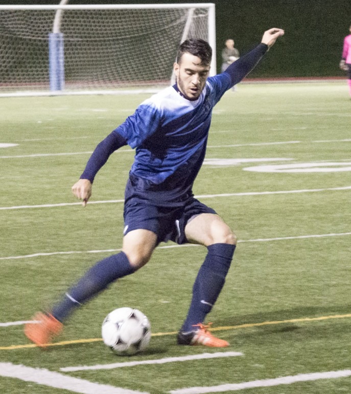 Humber Hawks' Marc Medeiros keeps the ball in play as he tries to move the ball up the field.