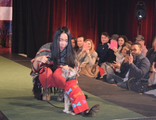 Aero the Yorkie and his owner Momo Yaang sporting pieces from Hotel Doggy and Sears for Purina PawsWay's doggie fashion show. (Christina Mulherin)