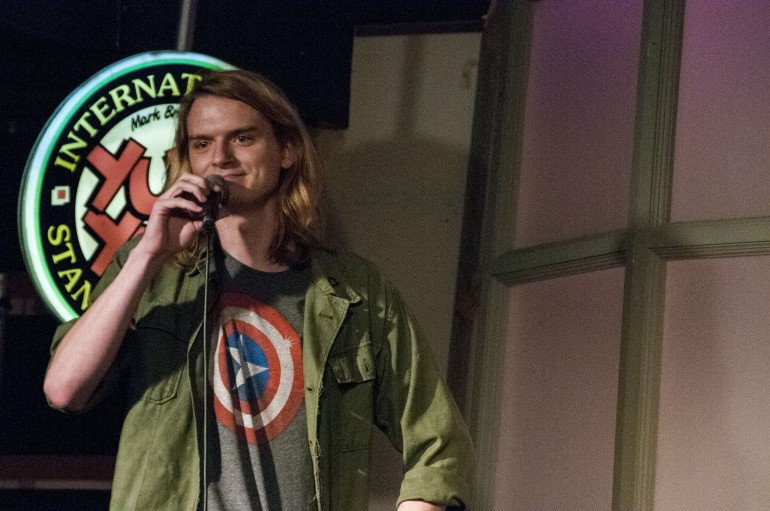Second year Humber comedy writing and performance student Taylor Smith performs stand-up at Yuk Yuks Comedy Club for Humber's amateur nights. (Julie Arounlasy)