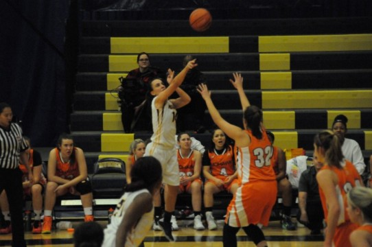 Hawks' guard Amber Bechard attempts a long range shot.  (Elliott Williams)