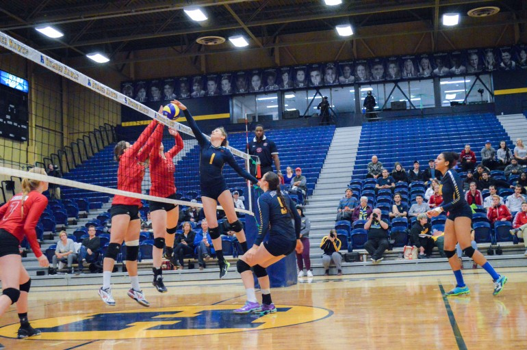 Gabie Miletic with a spike attempt against the Redeemer Royals on Feb. 1. Credit: McKenzie Barnes